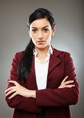 foto of trustworthiness  - Trustworthy latino business woman smiling with confidence - JPG