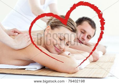 Affectionate couple having a back massage with closed eyes against heart