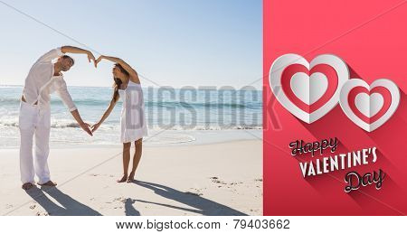 Cute couple forming heart shape with arms against happy valentines day