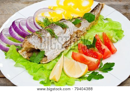 Fish Hake Baked With Vegetables On A Plate