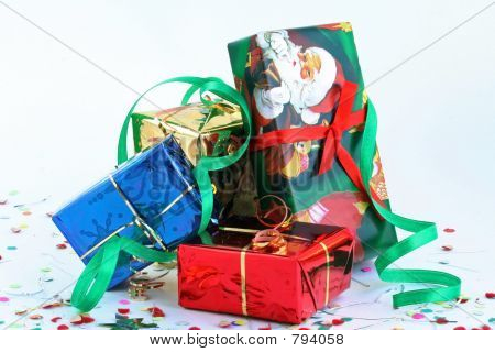 Boxes with gifts in celebratory packing over white
