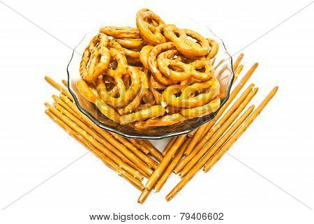 Some Tasty Salted Pretzels And Breadsticks On White
