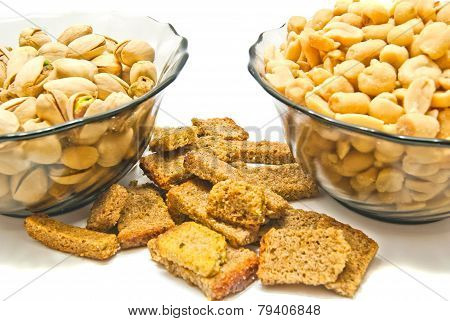 Two Plates With Tasty Nuts And Crackers