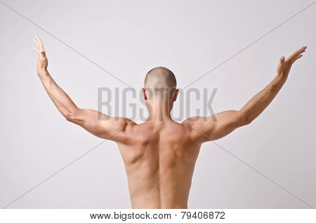 Topless dancer, man stripper posing with his back.