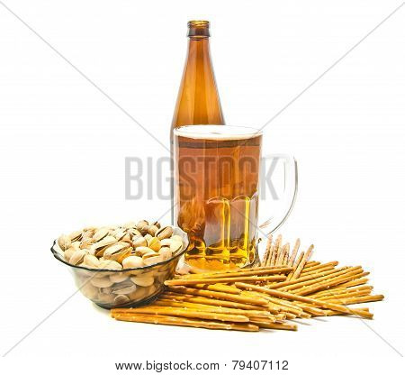 Breadsticks, Pistachios And Light Beer Closeup