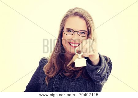 Young businesswoman ,real estate agent, with house keys in hand