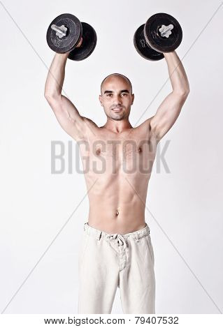 Strong man lifting the weights up.