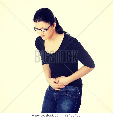 Young woman with stomach issues.