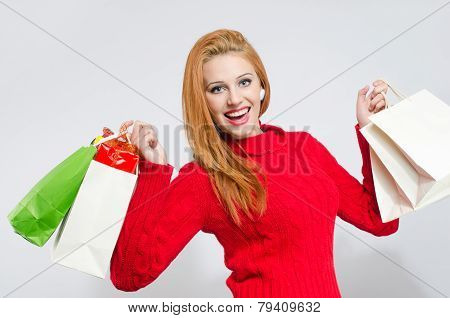 Happy young woman shopping for the Christmas holidays.