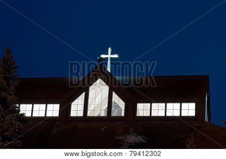 Church Cross And Nave Illuminated