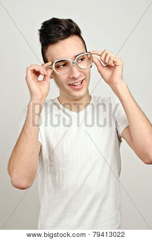 Young man with funny glasses smiling.