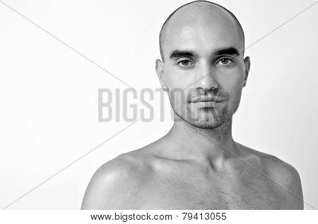 Portrait of a bald man.