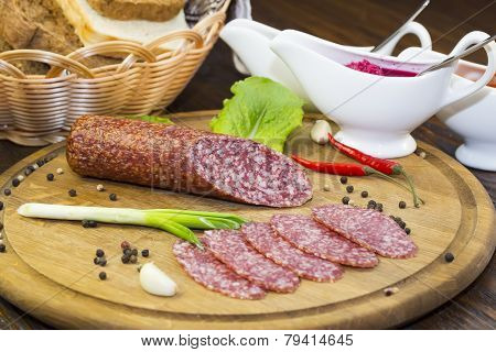 sausage on a wooden plate