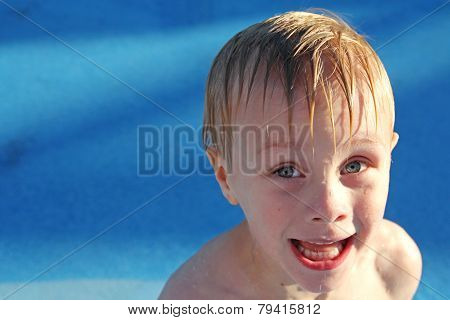 Child Making Funny Face In Swimming Pool