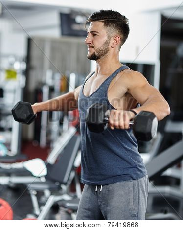 Man Doing Shoulder Workout In A Gym