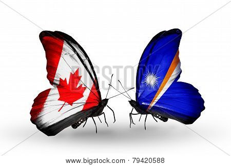 Two Butterflies With Flags On Wings As Symbol Of Relations Canada And Marshall Islands