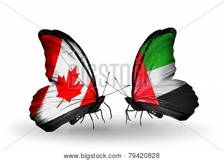 Two Butterflies With Flags On Wings As Symbol Of Relations Canada And Uae