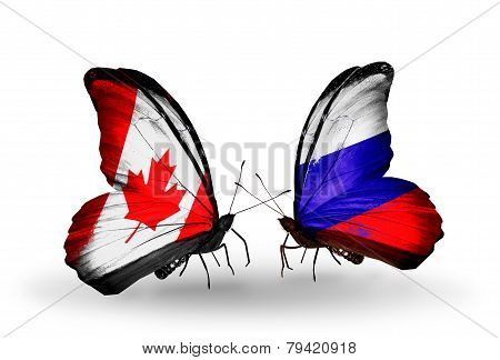 Two Butterflies With Flags On Wings As Symbol Of Relations Canada And Russia
