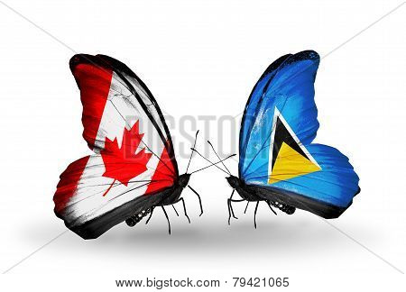 Two Butterflies With Flags On Wings As Symbol Of Relations Canada And Saint Lucia