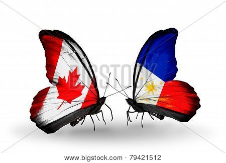 Two Butterflies With Flags On Wings As Symbol Of Relations Canada And Philippines