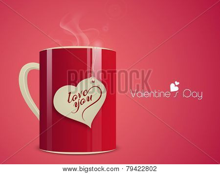 Love with coffee, heart shaped tag in a glossy coffee mug with text Love You on pink background for Happy Valentine's Day celebrations.