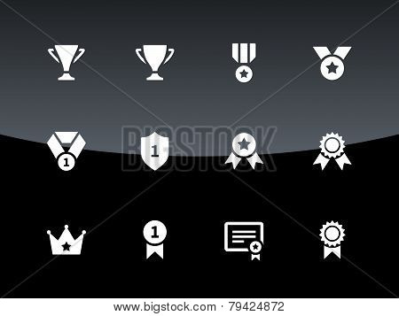 Trophy icons on black background.