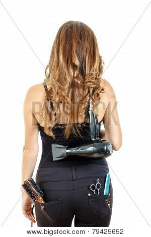 Professional Caucasian Brunette Female Hairdresser Posing From Behind With Hairdryer On Her Back