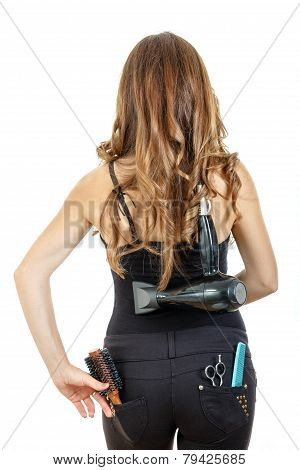Professional Caucasian Brunette Female Hairdresser Posing From Behind With Hairdryer On Her Back Wit