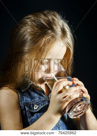 Cute Little Girl Drinking Clear Water