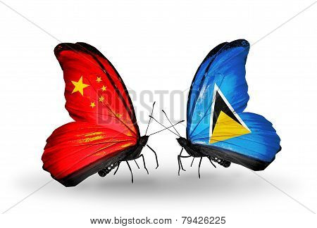 Two Butterflies With Flags On Wings As Symbol Of Relations China And Saint Lucia