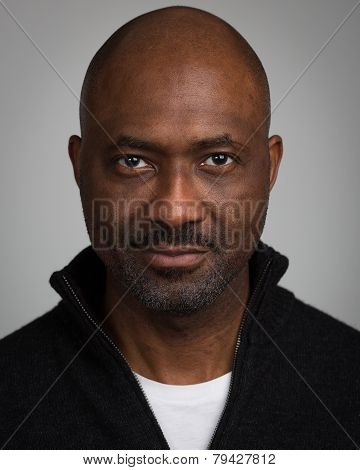 Bald Unshaven Black Man In His Forties