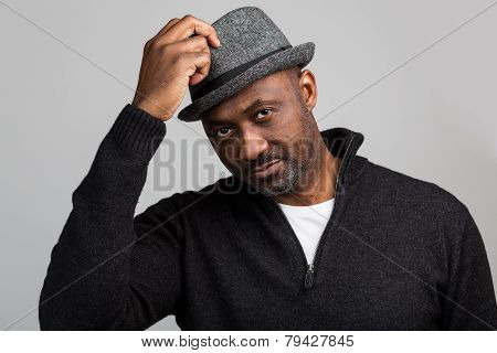 Black Unshaven Man Saluting With Hat