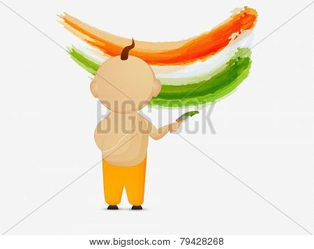 Religious Hindu boy painting in national flag colors for Indian Republic Day celebrations.