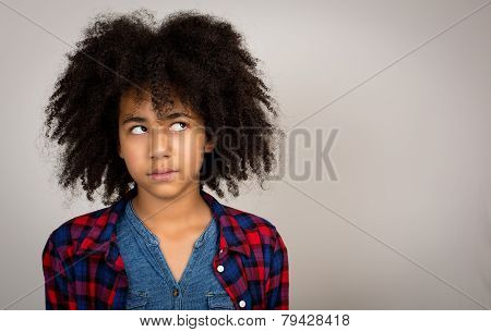 Young Teenage Girl With Afro Hair Thinking