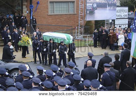 Honor guard with flag-draped coffin