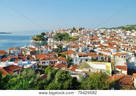 SKIATHOS, GREECE - SEPTEMBER 28, 2012: Looking down onto Skiathos Town and harbour on the Greek island of Skiathos. The island was the location for several scenes in the popular 2008 film Mamma Mia.