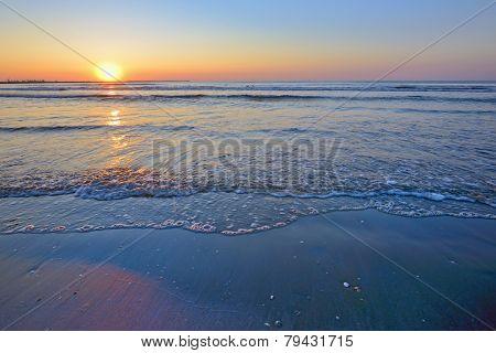 waves and sunrise on Black Sea beach