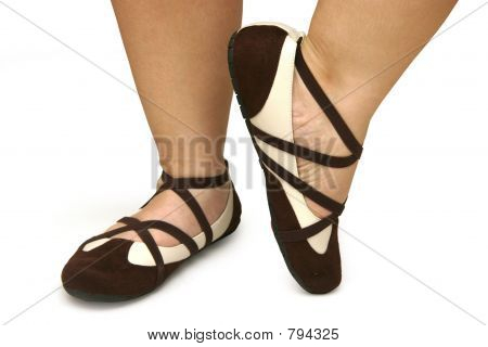 Brown and white dance shoes