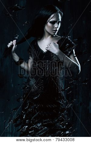 Woman In Black Dress Holding Hair With Broken Glass