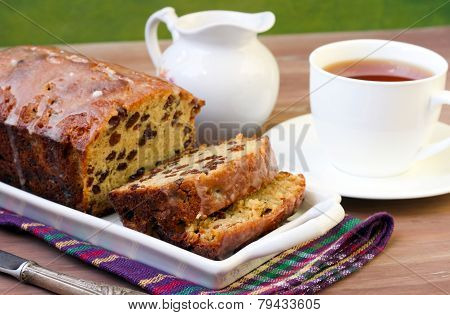Slices Of Raisin Loaf Cake And Cup Of Tea