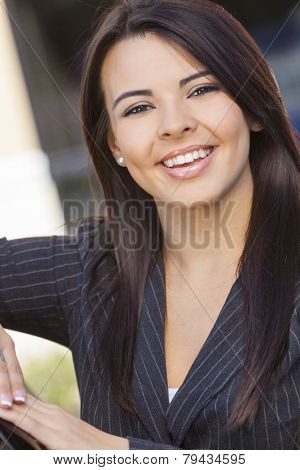 Outdoor portrait of a beautiful young Latina Hispanic business woman or businesswoman smiling