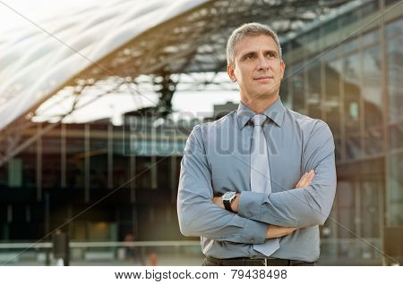 Satisfied Businessman Daydreaming In Front Of A Business Building