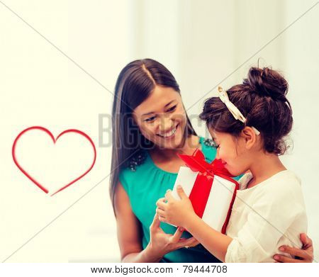 holidays, presents, christmas, x-mas, birthday concept - happy mother and child girl with gift box