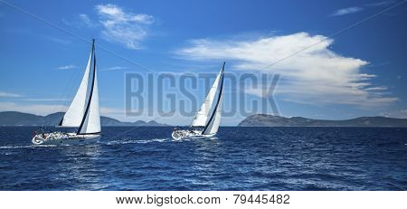 Panorama of the yacht race in the open sea. Sailing. Luxury yachts.