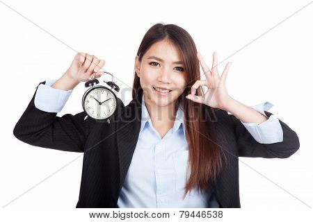 Young Asian Businesswoman Show Ok With Alarm Clock