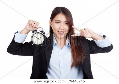 Young Asian Businesswoman Show V Sign With Alarm Clock