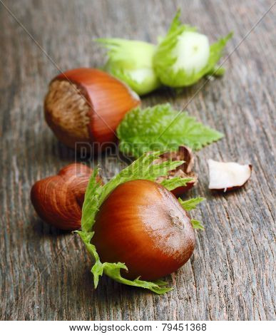 Forest nuts hazelnuts on wooden background.