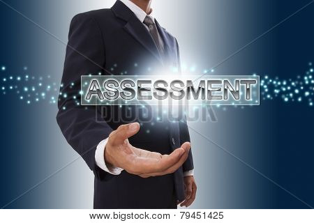 Businessman hand showing assessment button.
