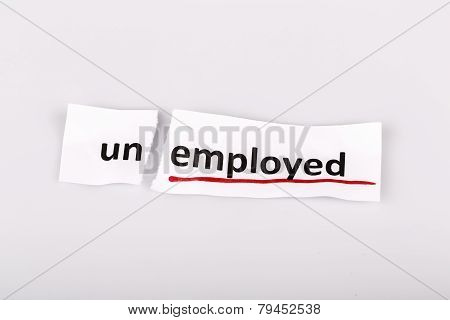 The Word Unemployed Changed To Employed On Torn Paper