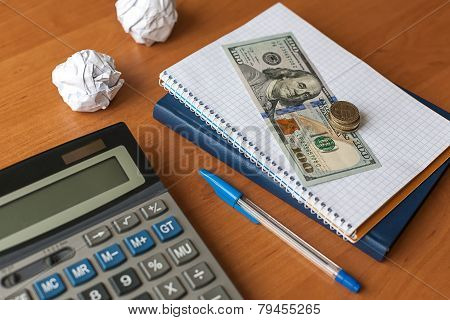 Business Desktop With Calculator, Notebook, Money